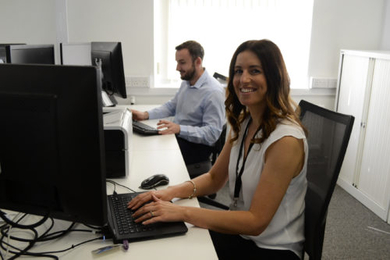 Woman and man working at their desks
