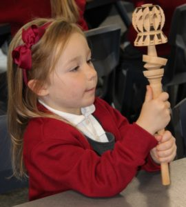 Girl with Mayan chocolate whisk