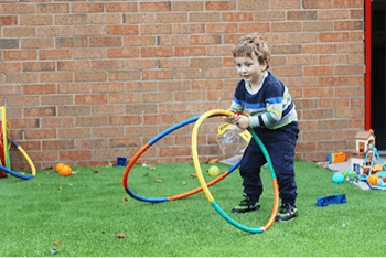 Boy playing with hoola hoops