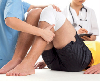 Physiotherapy checking injured knee