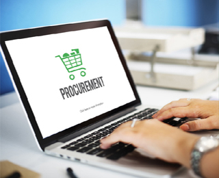 Laptop with the word procurement on the screen