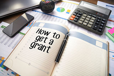 Diary with how to get a grant wrote in large letters
