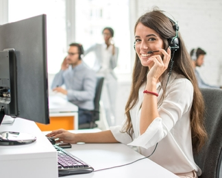Woman wearing a headset in a call centre